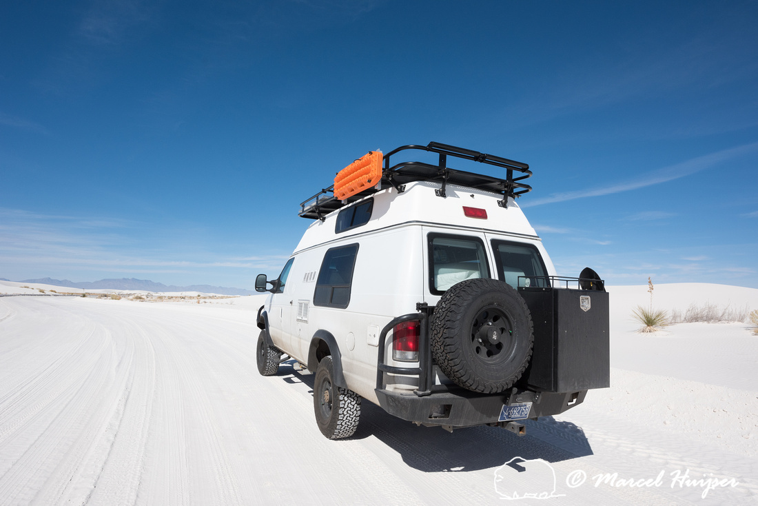 Camper van 4x4 on dirt road, White Sands National Monument, New