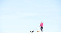 Woman and dogs, White Sands National Monument, New Mexico, USA