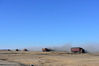 The unpaved coal haul road associated with the Tavan Tolgoi coal mine with coal trucks in Small Gobi B strictly protected area just north of Gashuun Sukhait (border), Gobi, Ömnögovi, Mongolia