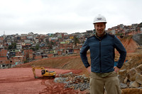 Marcel Huijser at a construction site of the Rodoanel Norte - the northern section of the outer belt way of Greater São Paulo, Brazil. The houses in the background are a favela (slums) that have been