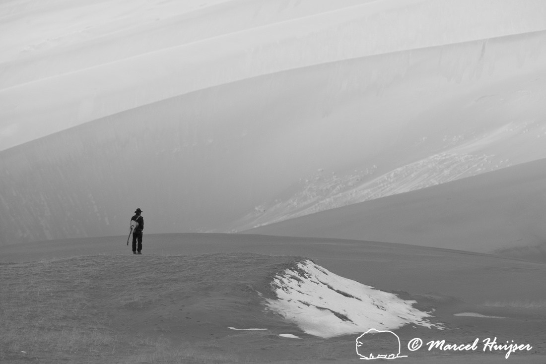 Man with guitar, Great Sand Dunes National Park and Preserve, Co