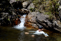 """Gamba"" Luiz Antônio cools off after a hike, Serra Fina (a section of Serra da Mantiqueira), near Passa Quatro, Minas Gerais, Brazil"