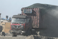 Coal trucks hauling coal to the border and dust, between Tsagaan khad (White Rock) and Gashuun-Sukhait, Gobi, Mongolia